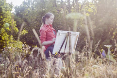 Artist on the plain air Stock Photo