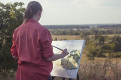 Artist on the plain air Royalty Free Stock Image