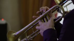 Artist playing trumpet on concert. Shot stock video footage