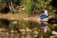 Artist by a Pond Stock Photography