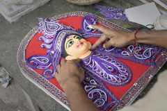 Artist preparing Goddess Durga clay idol, Kolkata, Calcutta, India Stock Photo