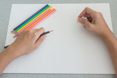 Artist preparing to sketch with colored pencils Royalty Free Stock Images