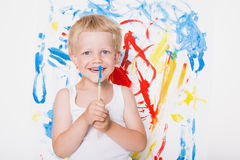 Artist preschool boy painting brush watercolors on a easel. School. Education. Creativity Stock Image