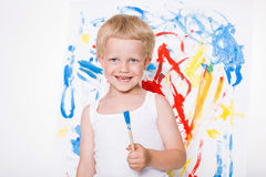Artist preschool boy painting brush watercolors on a easel. School. Education. Creativity Stock Images