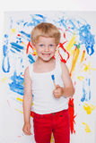 Artist preschool boy painting brush watercolors on a easel. School. Education. Creativity. Studio portrait over white background Royalty Free Stock Image