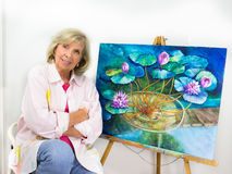 Artist Presents Her Finished Painting Royalty Free Stock Photos