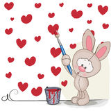 Artist Rabbit. Cute Rabbit with brush is drawing hearts Stock Photos