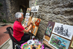 Artist in Rocca della Guaita, the most ancient fortress of San M Stock Photography
