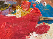 Artist's Abstract. A colorful artist's palette. Focus on the brush Stock Photo