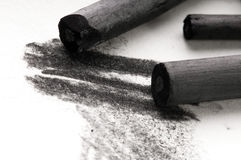 Artist's black charcoal with smudge Royalty Free Stock Photos