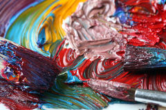 Artist's board with oil paint and paintbrushes Royalty Free Stock Images