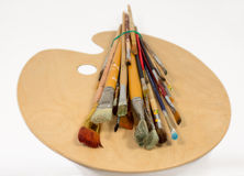 Artist's brush and palette for painting Royalty Free Stock Photos