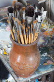 An artist's brushes covered with dust in studio Royalty Free Stock Photo