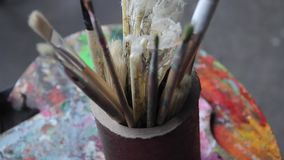 Artist`s brushes and vintage fan stock video footage