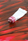 Artist's colorful red paint Royalty Free Stock Image