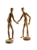 Artist's figures shaking hands. 2 artists figures posed as though shaking hands royalty free stock images