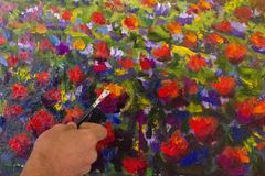 Art creative process. Artist create painting Italian summer countryside. Tuscany. Field of red poppies, a field of yellow rye. Rur. Artist`s hand close-up paint stock image