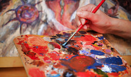 Artist's hand Paint a picture Stock Photos