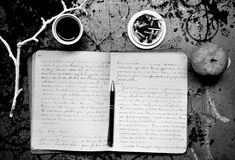 Artist's morning inspiration with notebook , coffee and cigarettes Royalty Free Stock Photo