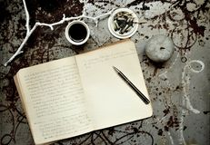 Artist's morning with notebook , coffee and cigarettes Stock Images