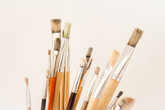 Artist's paint brushes with traces of dried paint. Royalty Free Stock Photos