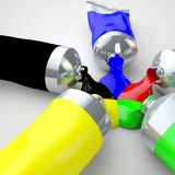 Color tubes. Spilling out onto and mixing Royalty Free Stock Photo
