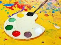 Artist's palette. Children's art palette and brush Stock Photography