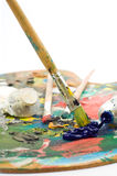 Artist's palette. With colorful paint and brushes Stock Images