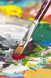 Artist's palette. Detail of a paintbrush on an artist's palette Stock Photo