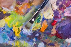 Artist's palette and brush. Artist's palette with multiple colors and brush Royalty Free Stock Image