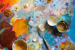 The artist's palette. Brush and oil paint Stock Photos