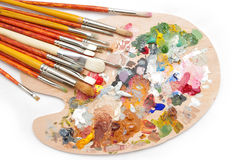 Artist's palette with brushes. On white background Royalty Free Stock Photo