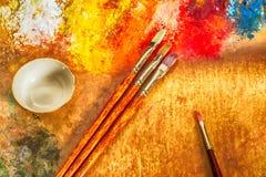 Artist's palette, brushes Stock Photos