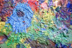 Artist`s palette with different colors.Wood. A variety of colors. Texture stock images