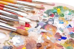 Artist's palette with multiple colors. And paintbrush Stock Photo