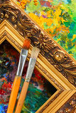 Artist's palette, paintbrushes and frame Stock Images