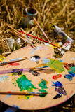 Artist's Palette with paints and brushes Stock Images