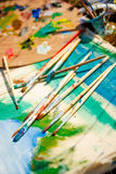 Artist's Palette with paints and brushes Stock Photos