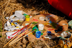 Artist's Palette with paints and brushes Stock Photography