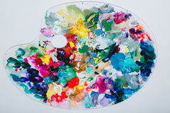 The artist`s palette stained with paint. On a white background, nobody.  Stock Images
