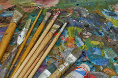 Artist`s palette, texture mixed oil paints in different colors and saturation Stock Photos