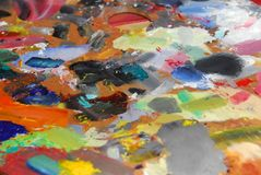 Artist's Pallette. A colorful artist's pallette covered in many strokes royalty free stock image