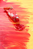 Artist's red and yellow paint Stock Photo