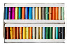 Artist's soft pastels box in different colors. On white background isolated royalty free stock photography