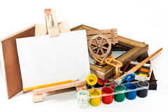 In the artist's studio. Easel, watercolor, pastels, canvas and picture frames on a white background Royalty Free Stock Image