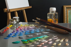 Artist's paint palette and workspace. Stock Image