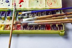 Watercolor paint on the table stock photos