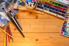 The artist`s tools on a wooden table. royalty free stock photo