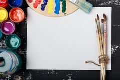 Artist`s workshop.Items for children`s creativity on a wooden background. Acrylic paint and brushes on white wooden background. Pi. Cture with copy space and for Royalty Free Stock Photos
