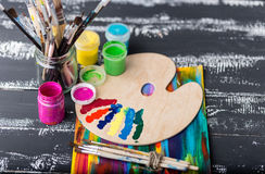 Artist`s workshop.Items for children`s creativity on a wooden background. Acrylic paint and brushes on white wooden background. Pi. Cture with copy space and for Royalty Free Stock Images